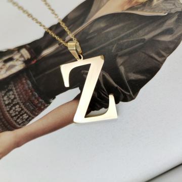 Naszyjnik stal chirurgiczna literka platerowana złotem NST1000Z